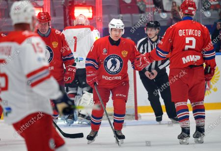 Russian President Vladimir Putin (C) takes part in a gala match with the participation of Russian hockey legends as part of the final stage of the X All-Russian Night Hockey League festival in the 'Bolshoi' Ice Palac in Sochi, Russia, 10 May 2021.