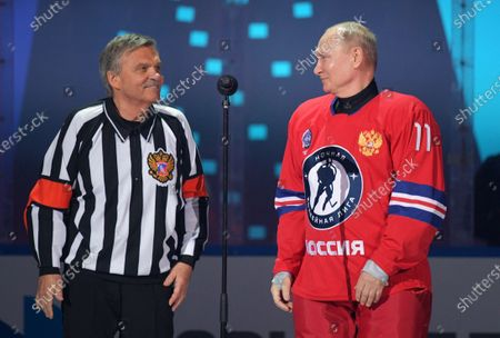 Russian President Vladimir Putin, right, and IIHF President Rene Fasel attend a gala match with the participation of Russian hockey legends as part of the final stage of the X All-Russian Night Hockey League festival in the Bolshoi Ice Palace in the Black Sea resort of Sochi, Russia