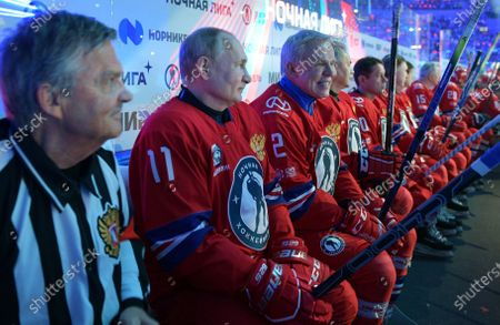 Russian President Vladimir Putin, second left, and IIHF President Rene Fasel, left, attend a gala match with the participation of Russian hockey legends as part of the final stage of the X All-Russian Night Hockey League festival in the Bolshoi Ice Palace in the Black Sea resort of Sochi, Russia