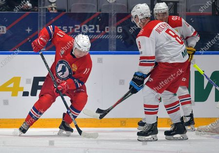 Russian President Vladimir Putin, left, attends a gala match with the participation of Russian hockey legends as part of the final stage of the X All-Russian Night Hockey League festival in the Bolshoi Ice Palace in the Black Sea resort of Sochi, Russia