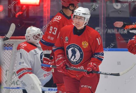 Russian President Vladimir Putin attends a gala match with the participation of Russian hockey legends as part of the final stage of the X All-Russian Night Hockey League festival in the Bolshoi Ice Palace in the Black Sea resort of Sochi, Russia
