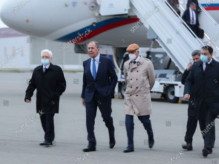 In this handout photo released by Russian Foreign Ministry Press Service, Russian Foreign Minister Sergey Lavrov, 2nd left, arrivers to Baku airport during his visit to Azerbaijan, in Baku, Azerbaijan