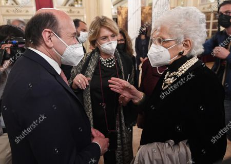 Italian Holocaust survivor and life Senator Liliana Segre (R), is welcomed by Teatro alla Scala Superintendent, French Dominique Meyer, both wearing face masks, upon her arrival in the foyer of the Teatro alla Scala to attend the concert directed by the musical director Riccardo Chailly that commemorates the 75th anniversary of the reopening of the Piermarini Hall after the years of the dictatorship, the II World War and the bombing with the historic concert directed by Arturo Toscanini on 11 May 1946, in Milan, Italy, 10 May 2021. Today's concert is the first event with the presence of audience since 19 October 2020. Only 500 tickets of the approximately 2000 seats were made available as required by current anti-covid legislation.