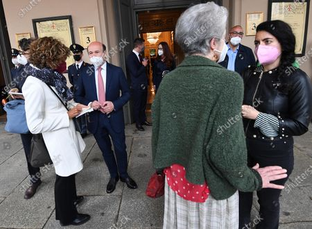 Teatro alla Scala Superintendent, French Dominique Meyer (2-L),wearing a face mask,at the entrance doors to the foyer of the Teatro alla Scala to attend the concert directed by the musical director Riccardo Chailly that commemorates the 75th anniversary of the reopening of the Piermarini Hall after the years of the dictatorship, the II World War and the bombing with the historic concert directed by Arturo Toscanini on 11 May 1946, in Milan, Italy, 10 May 2021. Today's concert is the first event with the presence of audience since 19 October 2020. Only 500 tickets of the approximately 2000 seats were made available as required by current anti-covid legislation.
