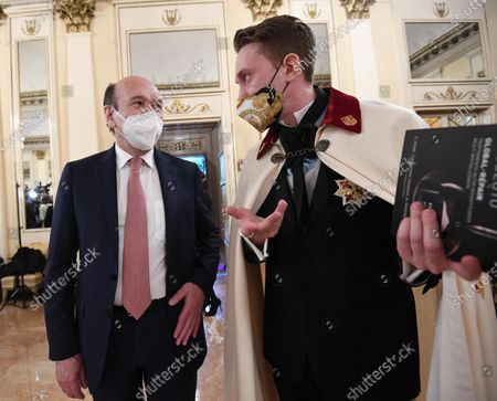Stock Picture of Teatro alla Scala Superintendent, French Dominique Meyer (L),listen to a guest, both wearing a face masks,at the foyer of the Teatro alla Scala to attend the concert directed by the musical director Riccardo Chailly that commemorates the 75th anniversary of the reopening of the Piermarini Hall after the years of the dictatorship, the II World War and the bombing with the historic concert directed by Arturo Toscanini on 11 May 1946, in Milan, Italy, 10 May 2021. Today's concert is the first event with the presence of audience since 19 October 2020. Only 500 tickets of the approximately 2000 seats were made available as required by current anti-covid legislation.