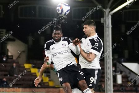 Stock Picture of Fulham's Andre-Frank Zambo Anguissa, left, and Fulham's Aleksandar Mitrovic jump for a header during the English Premier League soccer match between Fulham and Burnley at the Craven Cottage Stadium in London