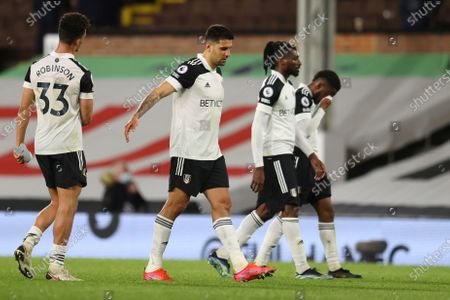 Fulham's Aleksandar Mitrovic, center, walks with other players after the English Premier League soccer match between Fulham and Burnley at the Craven Cottage Stadium in London