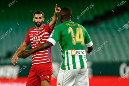 Maxime Gonalons of Granada CF and William Carvalho of Real Betis