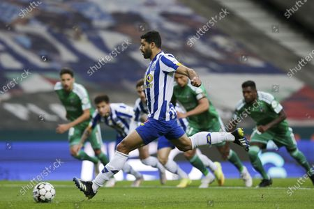 FC Porto players Mehdi Taremi scores a penalty goal during the Portuguese First League soccer match between FC Porto and SC Farense at Dragao stadium, Porto, Portugal, 10 May 2021.
