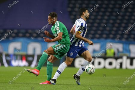 FC Porto's Mehdi Taremi (R) in action against Farense's Amine Oudrhiri during the Portuguese First League soccer match between FC Porto and SC Farense at Dragao stadium, Porto, Portugal, 10 May 2021.