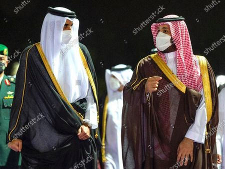 Stock Photo of In this photo released by Saudi Royal Palace, Saudi Crown Prince Mohammed bin Salman, right, greets Qatar's Emir Sheikh Tamim bin Hamad Al Thani upon his arrival at in the Red Sea city of Jiddah, Saudi Arabia, . Qatar's ruling emir is visiting Saudi Arabia for the first time since signing a declaration with other Arab Gulf states to ease a years-long rift and end an embargo that had frayed ties among important U.S. allies and security partners