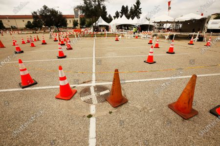 Stock Image of Signs and traffic cones direct traffic to the vaccination area at Pierce College's COVID-19 testing and vaccination center in Woodland Hills as the Los Angeles Fire Department, CORE and Carbon Health, are making Covid-19 vaccination available for walk-ins starting today, Monday May 10, 2021. Los Angeles will offer appointment-free COVID-19 vaccinations at all of its city-run sites and open two additional night clinics in a new effort to expand vaccine access, Mayor Eric Garcetti said. All three vaccination options - Pfizer, Moderna, Johnson & Johnson are currently available at Pierce College. Pierce College on Monday, May 10, 2021 in Woodland Hills, CA. ({a} / Los Angeles Times).