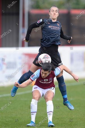 Kenza Dali of West Ham Women Lucy Bronze of Manchester City Women in action during WomenÕs Super League match between West Ham Women and Manchester City Women at The Chigwell Construction Stadium in London - 9th May 2021