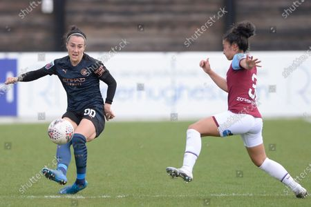 Maz Pachezo of West Ham Women and Lucy Bronze of Manchester City Women in action during WomenÕs Super League match between West Ham Women and Manchester City Women at The Chigwell Construction Stadium in London - 9th May 2021