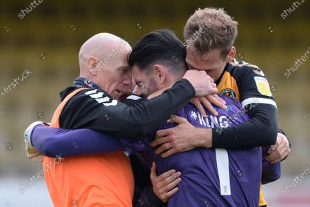 Tom King of Newport County celebrates with Mickey Demetriou after the Sky Bet League Two match between Southend United and Newport County at Roots Hall in Southend - 8th May 2021