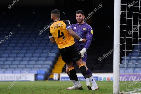 Tom King of Newport County celebrates saving Matt RushÕs penalty with Joss Labadie during Sky Bet League Two match between Southend United and Newport County at Roots Hall in Southend - 8th May 2021