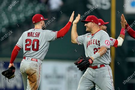 Los Angeles Angels' Jared Walsh (20) celebrates with Mike Trout after a baseball game against the Houston Astros, in Houston. The Angels won 5-4