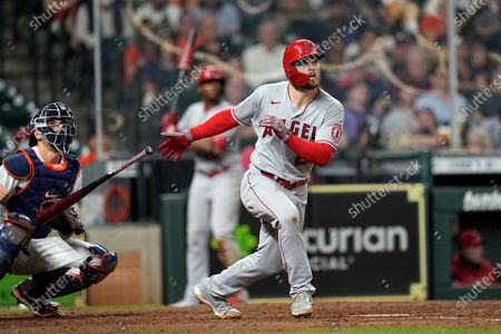 Los Angeles Angels' Jared Walsh, right, hits a home run as Houston Astros catcher Jason Castro watches during the sixth inning of a baseball game, in Houston
