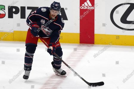 Columbus Blue Jackets defenseman Michael Del Zotto controls the puck during an NHL hockey game against Detroit Red Wings in Columbus, Ohio