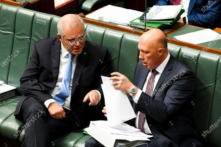 Australian Prime Minister Scott Morrison (L) speaks to Australian Defence Minister Peter Dutton (R) during House of Representatives Question Time at Parliament House in Canberra, Australia, 11 May 2021.