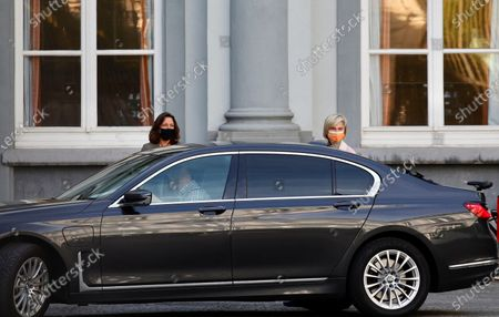 Flemish Minister of Employment, Economy, Social Economy and Agriculture Hilde Crevits, right, arrives for a Belgian government meeting to discuss coronavirus, COVID-19, measures in Brussels