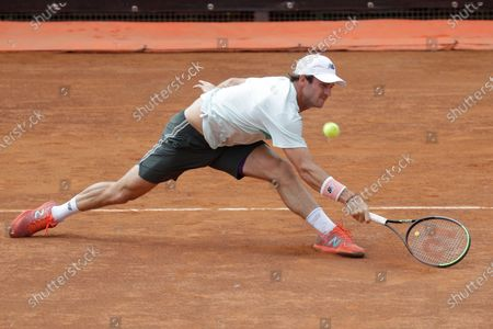 Tommy Paul, of the United States, returns the ball to Spain's Roberto Bautista Agut during their match at the Italian Open tennis tournament, in Rome