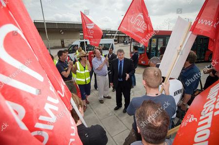 Unite joint leader  Derek Simpson talking to striking BA cabin crew on the picket line at Hatton Cross rail station, near Heathrow