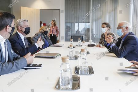 United Nations High Commissioner for Refugees Filippo Grandi, second left, and European Union foreign policy chief Josep Borrell, right, attend a meeting at the EEAS building in Brussels