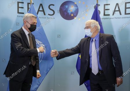 United Nations High Commissioner for Refugees Filippo Grandi, left, is greeted with a fist bump by European Union foreign policy chief Josep Borrell prior to a meeting at the EEAS building in Brussels