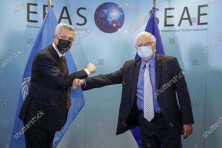 United Nations High Commissioner for Refugees Filippo Grandi, left, is greeted with an elbow bump by European Union foreign policy chief Josep Borrell prior to a meeting at the EEAS building in Brussels