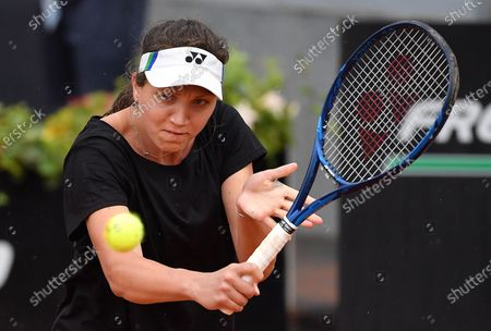 Patricia Maria Tig of Romania in action against Garbine Muguruza of Spain  during their women's singles first round match at the Italian Open tennis tournament in Rome, Italy, 11 May 2021.