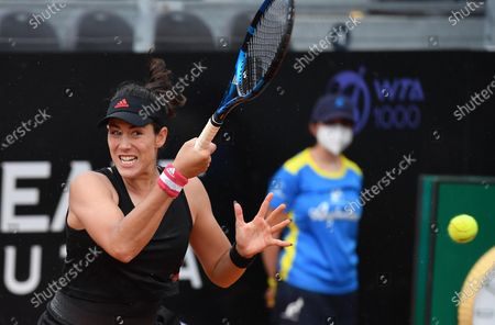 Garbine Muguruza of Spain in action against Patricia Maria Tig of Romania during their women's singles first round match at the Italian Open tennis tournament in Rome, Italy, 11 May 2021.