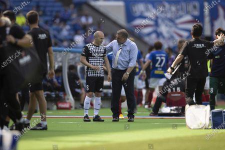Stock Image of Andres Iniesta (Vissel) Ange Postecoglou (Marinos) L-R - Football / Soccer : 2021 J1 League match between Yokohama F Marinos 2-0 Vissel Kobe at Nissan Stadium in Kanagawa, Japan.