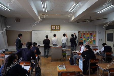 Pictures of Kim Il Sung and Kim Jong Il hang on the wall as students solve math quizzes on a whiteboard in a math class at Hiroshima Korean School on May 9, 2021 in Hiroshima, Japan. The school provides kindergarten to high school education for the Korean descendants in Japan, whose family moved from Korean Peninsula during Japanese colonial rule from 1910 to 1945. Democratic People's Republic of Korea has been establishing ties and stays influential in their higher education. Most of Japan's 48 prefectures have Korean Schools.