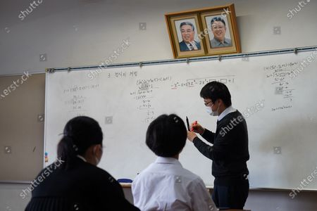Pictures of Kim Il Sung and Kim Jong Il hang on the wall as a teacher conducts a math lecture at Hiroshima Korean School on May 9, 2021 in Hiroshima, Japan. The school provides kindergarten to high school education for the Korean descendants in Japan, whose family moved from Korean Peninsula during Japanese colonial rule from 1910 to 1945. Democratic People's Republic of Korea has been establishing ties and stays influential in their higher education. Most of Japan's 48 prefectures have Korean Schools.