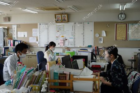 Pictures of Kim Il Sung and Kim Jong Il hang on the wall as teachers prepares for their lectures in teachers's room at Hiroshima Korean School on May 9, 2021 in Hiroshima, Japan.