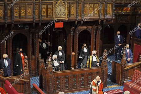 Stock Image of Britain's Prime Minister Boris Johnson, left, Black Rod Sarah Clarke, Speaker of the House of Commons Sir Lindsay Hoyle and Leader of the Opposition Kier Starmer, right, listen as Queen Elizabeth II delivers a speech in the House of Lords at the Palace of Westminster in London