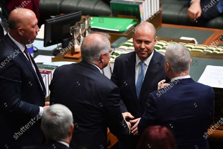 Treasurer Josh Frydenberg is congratulated by Minister for Defence Peter Dutton after delivering the 2021-22 Budget in the House of Representatives at Parliament House in Canberra, Australia, 11 May 2021.