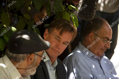 Sven Kuhn von Burgsdorff, center, the European Union representative for the Palestinian Territories, center, listens to Nabil al-Kurd, left, a resident of the Sheikh Jarrah neighborhood of east Jerusalem, who is from one of several Palestinian families under threat of forced eviction