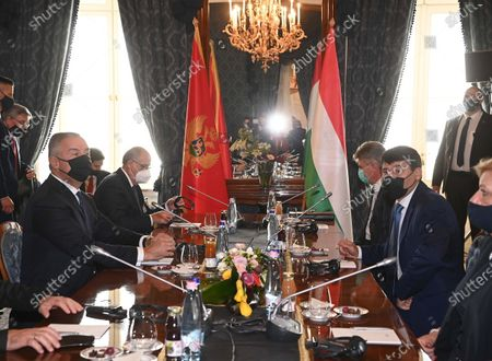 Montenegrin President Milo Djukanovic (L) and his Hungarian counterpart Janos Ader (2-R) start plenary talks during their meeting in the presidential Alexander Palace in Budapest, Hungary, 11 May 2021.