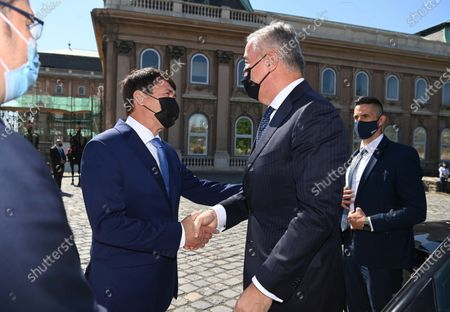 Hungarian President Janos Ader (L) welcomes his Montenegrin counterpart Milo Djukanovic (R) during the welcoming ceremony at the presidential Alexander Palace in Budapest, Hungary, 11 May 2021.