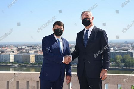 Montenegrin President Milo Djukanovic (R) shakes hands with his Hungarian counterpart Janos Ader (L) on the terrace of the presidential Alexander Palace in Budapest, Hungary, 11 May 2021.