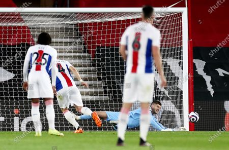 Fraser Forster of Southampton saves the penalty of Luka Milivojevic of Crystal Palace.