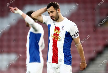 Luka Milivojevic of Crystal Palace rubs his head.