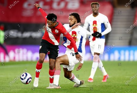 Kyle Walker-Peters of Southampton is tackled by Jairo Riedewald of Crystal Palace.