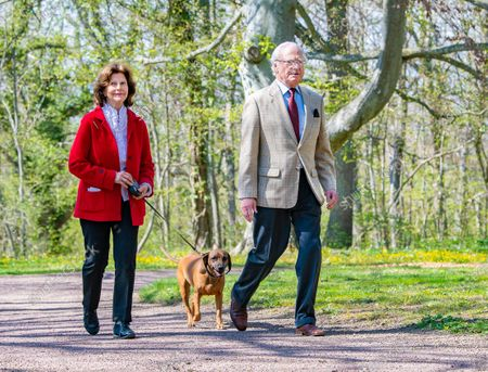 "Queen Silvia, with the royal dog Brandie, and King Carl Gustaf of Sweden inaugurate glass artist Bertil Vallien's exhibition ""Gatekeeper"" at Solliden Palace on Oland, Sweden, on May 11, 2021."