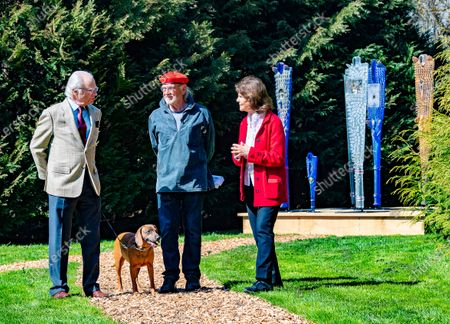 "Queen Silvia, dog Brandie and King Carl Gustaf of Sweden inaugurate glass artist Bertil Vallien's exhibition ""Gatekeeper"" at Solliden Palace on Oland, Sweden, on May 11, 2021."