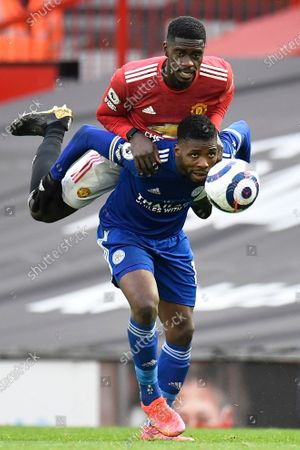 Manchester United's Axel Tuanzebe (L) and Leicester's Kelechi Iheanacho (R) in action during the English Premier League soccer match between Manchester United and Leicester City in Manchester, Britain, 11 May 2021.