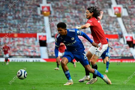 Leicester's Wesley Fofana (L) and Manchester United's Edinson Cavani (R) in action during the English Premier League soccer match between Manchester United and Leicester City in Manchester, Britain, 11 May 2021.