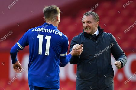 Leicester's manager Brendan Rodgers (R) and Leicester's Marc Albrighton (L) celebrate after the English Premier League soccer match between Manchester United and Leicester City in Manchester, Britain, 11 May 2021.